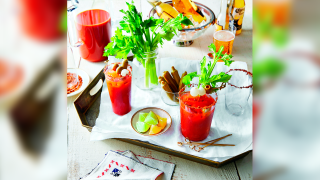 a Bloody Mary bar with celery and melons