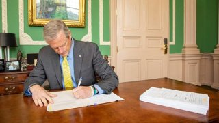 Gov. Charlie Baker signs Massachusetts' budget into law on Friday, July 16, 2021.