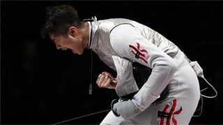 Cheung Ka Long celebrates winning a fencing bout a the Tokyo Olympics