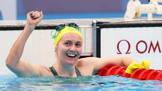Ariarne Titmus of Australia celebrates victory in the women's 400m freestyle over Katie Ledecky.