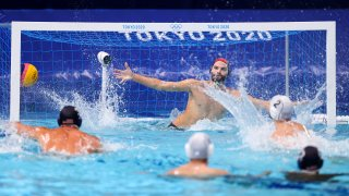 Konstantinos Genidounias of Team Greece scores a goal past Drew Holland of Team United States during the Men's Preliminary Round Group A match between Greece and the United States on day ten of the Tokyo 2020 Olympic Games at Tatsumi Water Polo Centre on Aug. 2, 2021, in Tokyo, Japan.