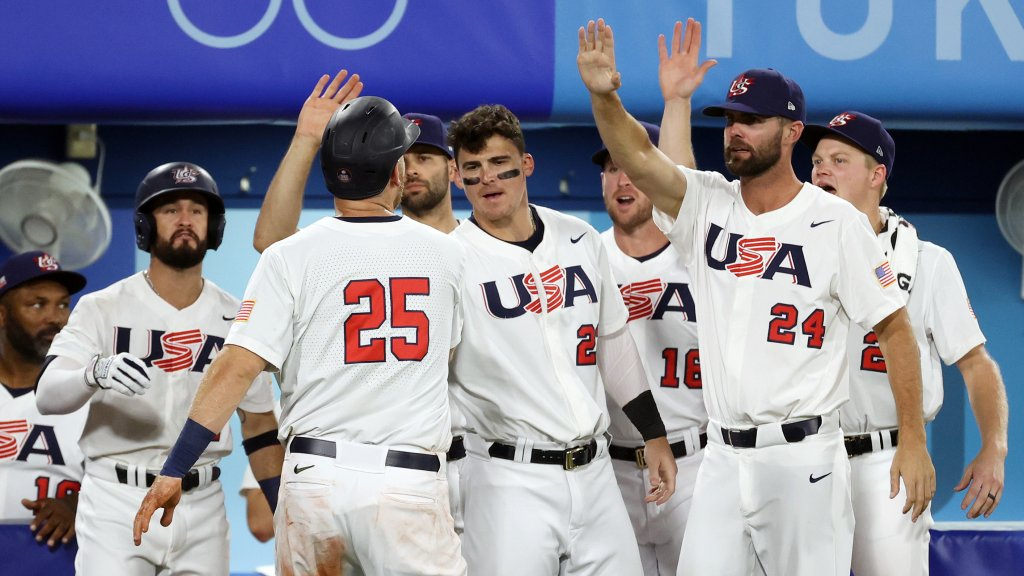 Todd Frazier #25 of Team United States returns to the dugout after scoring in the sixth inning against South Korea during the semifinals of the men's baseball on day thirteen of the Tokyo 2020 Olympic Games at Yokohama Baseball Stadium on Aug. 5, 2021 in Yokohama, Japan.