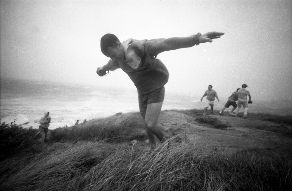 People play in the high winds of Hurricane Bob at Nobska Point in Woods Hole, Mass., on Aug. 19, 1991.