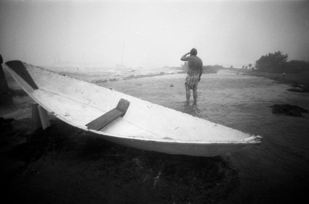 A person looks out over Great Harbor in Woods Hole, Mass., on Aug. 19, 1991, during Hurricane Bob.