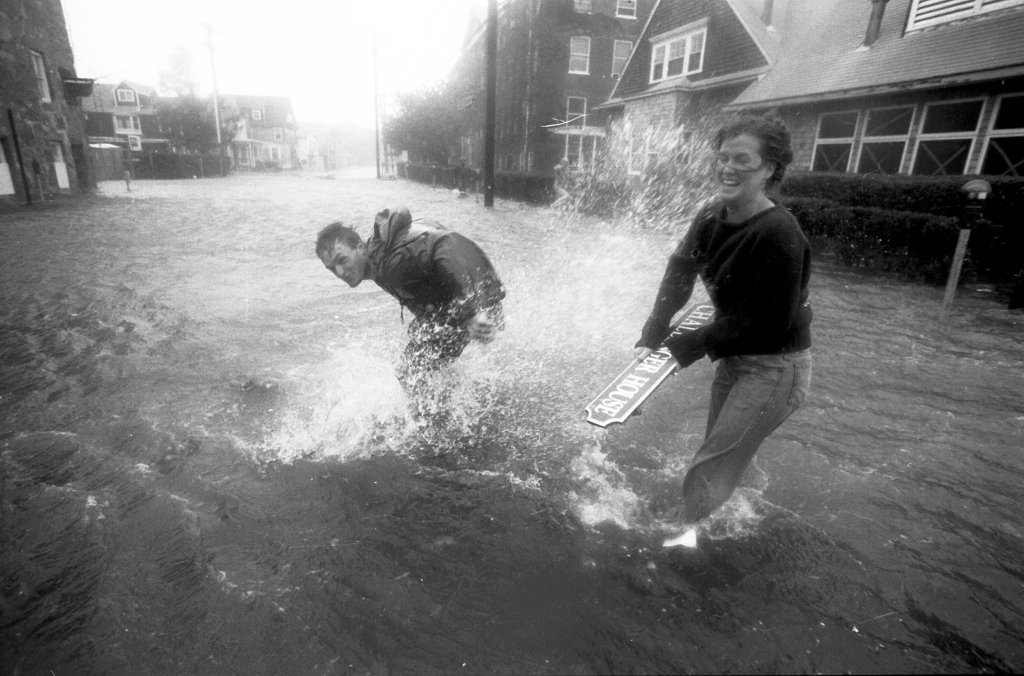 Two people play in a flooded Water Street in downtown Woods Hole, Mass., during Hurricane Bob on Aug. 19, 1991.