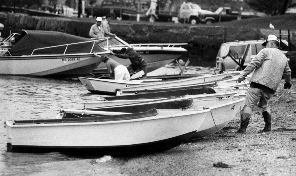 People pull their boats out of Hingham Harbor in Hingham, Mass., on Aug. 19, 1991, ahead of Hurricane Bob.