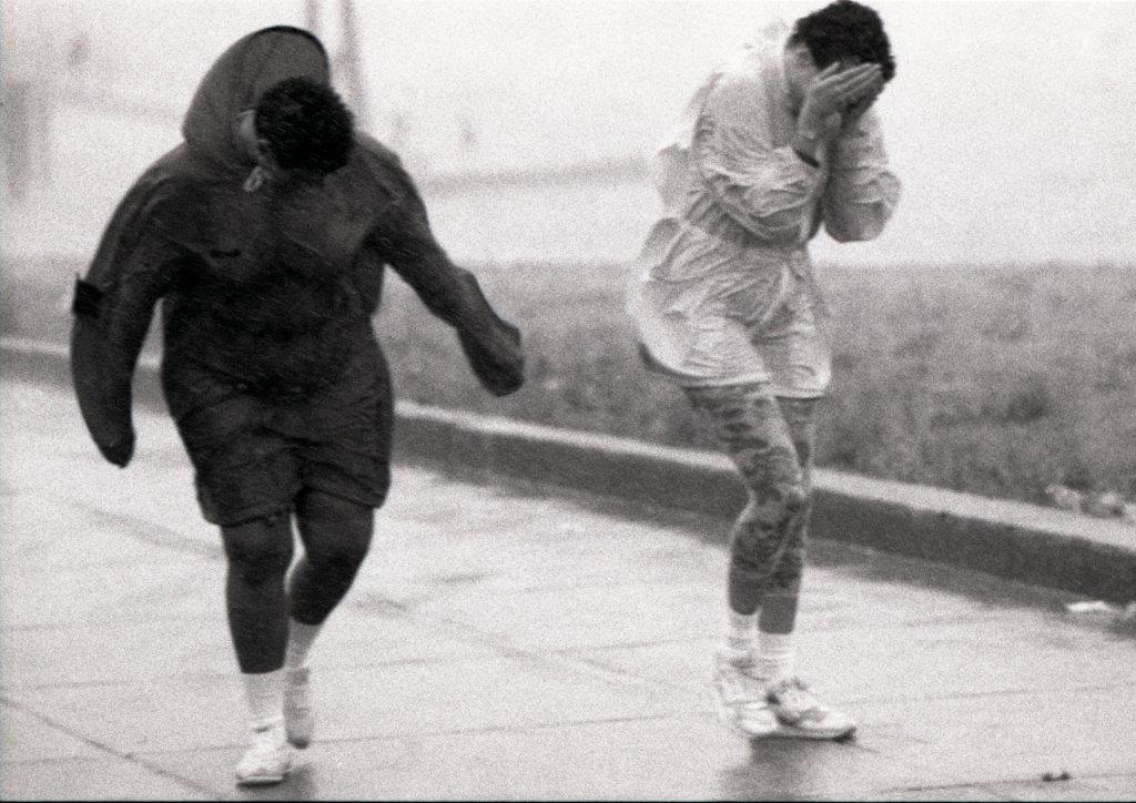 People walk into the wind in Boston during Hurricane Bob on Aug. 19, 1991.