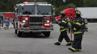 Firefighters responding to a hazardous materials call in Wakefield, Massachusetts, on Monday, Aug. 23, 2021.