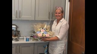 Lisa Mackin, owner and operator of Boston Baked Blooms, in her South Boston kitchen with the edible cupcakes bouquets she makes there.