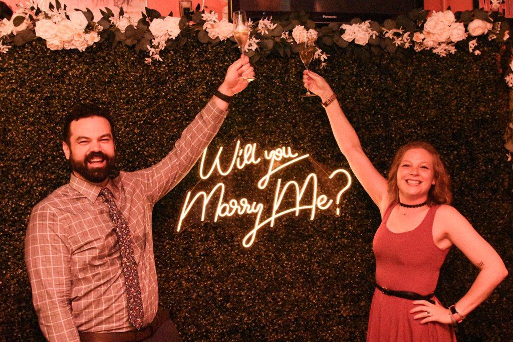 Matt Champlin and Christine Corning toasting their proposal