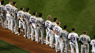 The New York Yankees and the New York Mets lined up