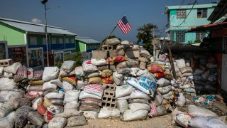 A U.S. national flag tops a barricade delimiting territorial gang control in the Bel Air neighborhood of Port-au-Prince, Haiti