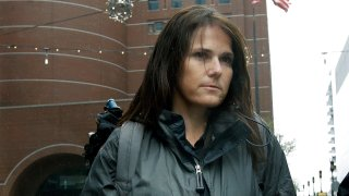 Former University of Southern California soccer coach Laura Janke departs federal court, Tuesday, May 14, 2019, in Boston, where she pleaded guilty to charges in a nationwide college admissions bribery scandal.