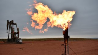 FILE - In this Aug. 26, 2021 file photo, a flare burns natural gas at an oil well Aug. 26, 2021, in Watford City, N.D. Consumers of natural gas are facing the prospect of much higher heating bills this winter. That's after enjoying a prolonged period of low prices.