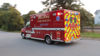 An ambulance leaves the scene of a stabbing in Bourne, Massachusetts, on Monday, Sept. 27, 2021.