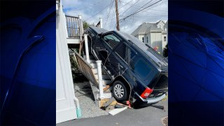 An SUV that crashed up a staircase in Waltham, Massachusetts