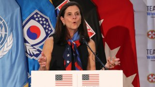 FILE - In this Aug. 1, 2017, file photo, then-U.S. Olympic Committee chief marketing officer Lisa Baird speaks about the Team USA WinterFest for the upcoming 2018 Pyeongchang Winter Olympic Games, at Yongsan Garrison, a U.S. military base in Seoul, South Korea. National Women's Soccer League Commissioner Lisa Baird is out after some 19 months on the job amid allegations that a former coach engaged in sexual harassment and misconduct toward players, a person with knowledge of the situation told The Associated Press. The person spoke to the AP on the condition of anonymity because the move Friday, Oct. 1, 2021 had not been made public.