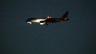 A plane landing at Boston Logan International Airport