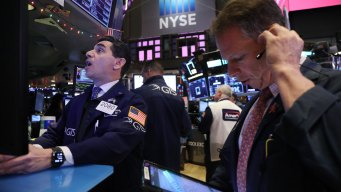 Stocks Claw Back From an Early Plunge on Fed Report