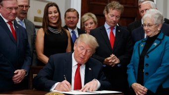 Business Owner Faces Backlash for Attending Trump Signing