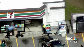 Crews Remove Car from 7-11