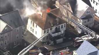 Crews Battle House Fire in Malden, Massachusetts