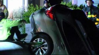 Car Hangs Off Pier in Charlestown