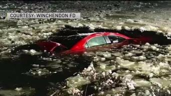 Driver Rescued After Car Crashed Into Icy Pond