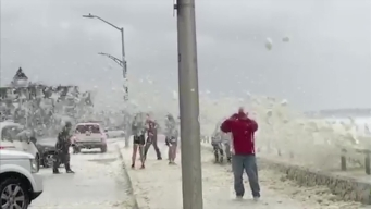 Heavy Foam Blankets Nantasket Beach During Storm
