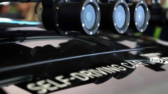Robot Being Developed to Make Any Car a Self-Driving One