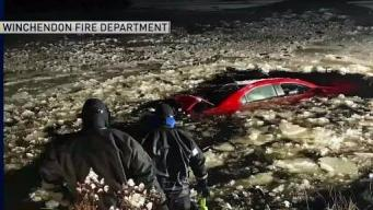 Driver Rescued After Car Crashes Into Icy Pond