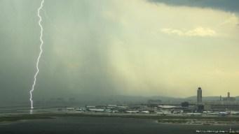 Storm Hits Boston; Microburst Halts Flights at Logan Airport