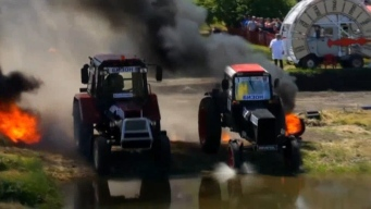 Tractors Race Through Mud, Puddles and Fire in Russia