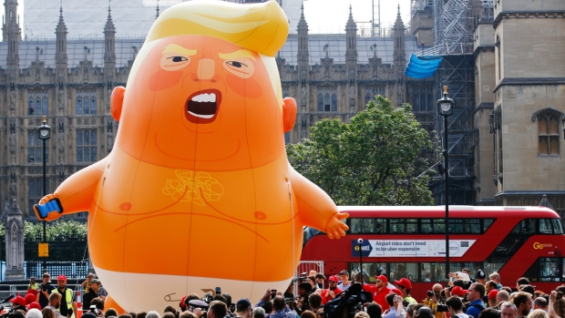 [NATL] Protesters Launch Giant Baby Trump Balloon in London