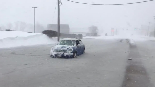 Car Stuck Frozen in Flooded Street