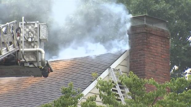 [NECN]Lightning Causes Fire at Wellesley Home