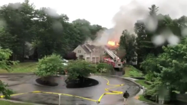 [NECN]Flames Shoot From Norwell Home's Roof After Lightning Strike