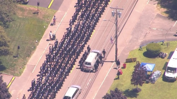 [NECN] Procession Leaves Church Following Sgt. Chesna's Funeral