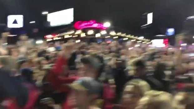 [NECN] Red Sox Fans Sing 'We Are The Champions'