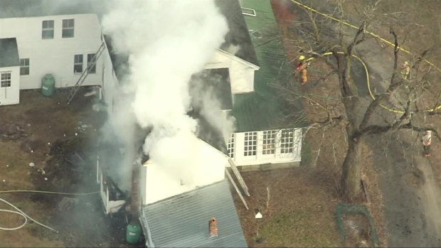 [NECN] Aerials: Crews Battle Fire at Bolton Home