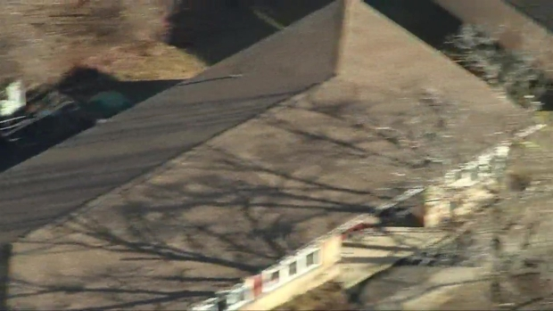 [NECN] AERIALS: Police Investigate Death at Clinton Housing Complex