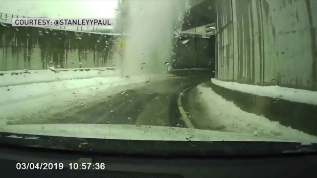 [NECN] WATCH: Snow Falls on Passing Vehicle at Logan Airport, Cracking Windshield
