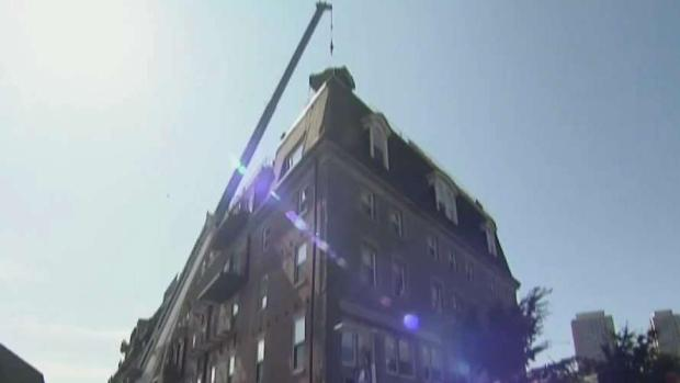 [NECN] Contractors Cited After Debris Critically Injures Woman