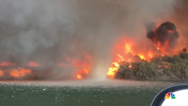[NATL] WATCH: Roaring California Fire Spins Up Waterspout