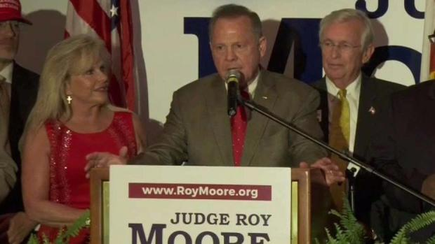 Aide says Trump sees allegations against Moore as credible