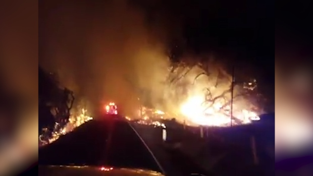 [NATL] Firefighters Drive Through Southern California Wildfire