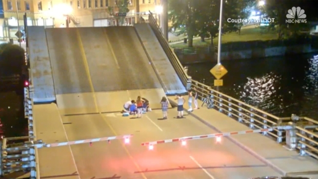 [NATL-NY] Shocking Video Shows Woman on Bicycle Fall Through Bridge Gap