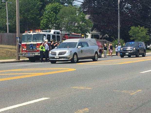 IMAGES: Memorials, Procession for Slain Weymouth Officer, Woman