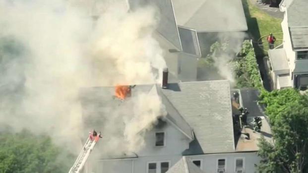 [NECN] 3 People Including 2 Firefighters Injured in Everett Blaze