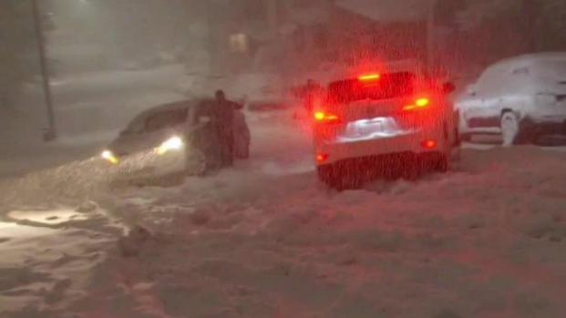 [NECN]RAW VIDEO: Man Nearly Crushed by Sliding Car